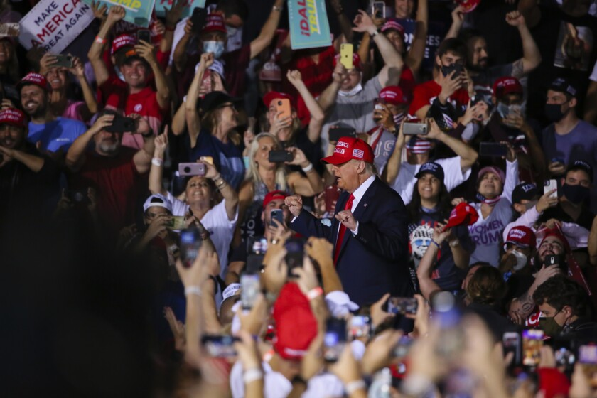 President Trump is surrounded by a crowd as he arrives at a campaign rally in Miami on Nov. 2.