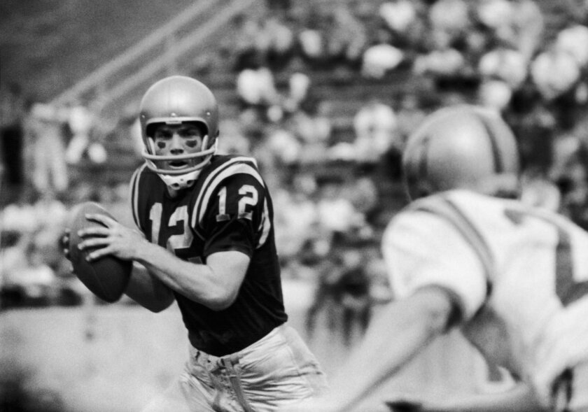 Roger Staubach, a junior quarterback from Cincinnati, throws a pass at the Navy field in Annapolis, MD, in the 1963 season.