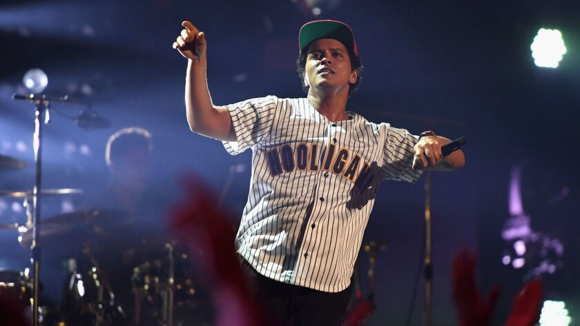 Bruno Mars, seen performing at June's BET Awards, employed his musicianly know-how in the first of four concerts at the Forum.