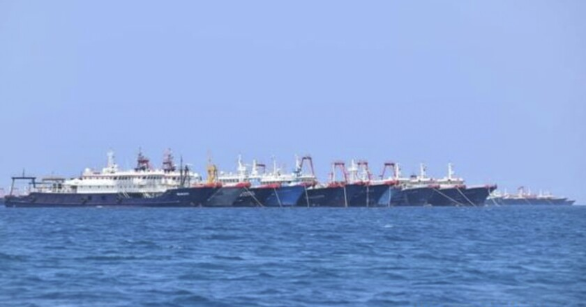 Chinese vessels are seen moored at Whitsun Reef, South China Sea