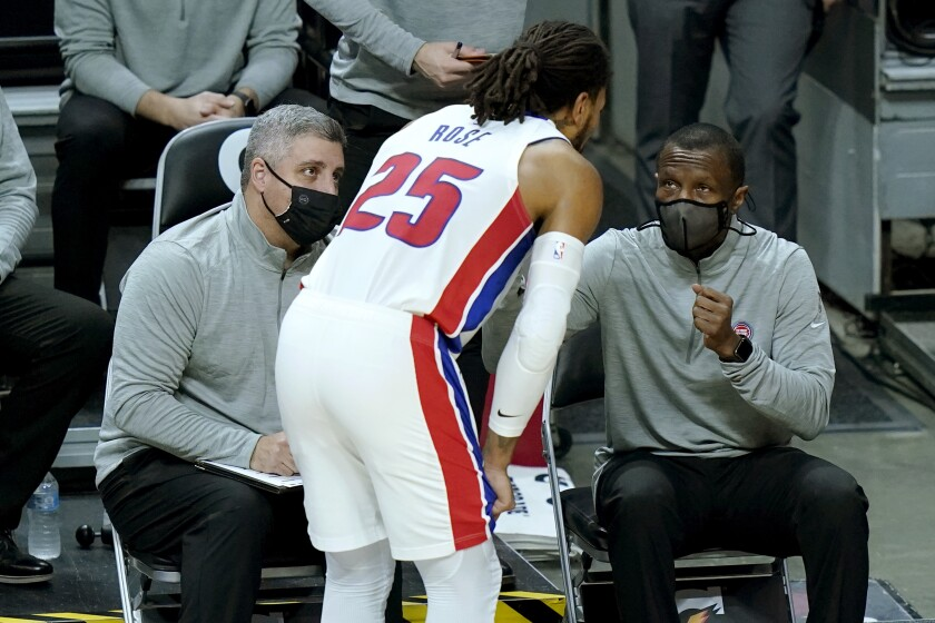 Detroit Pistons head coach Dwane Caseym], right, talks with guard Derrick Rose (25) during the first half of an NBA basketball game against the Miami Heat, Saturday, Jan. 16, 2021, in Miami. (AP Photo/Lynne Sladky)