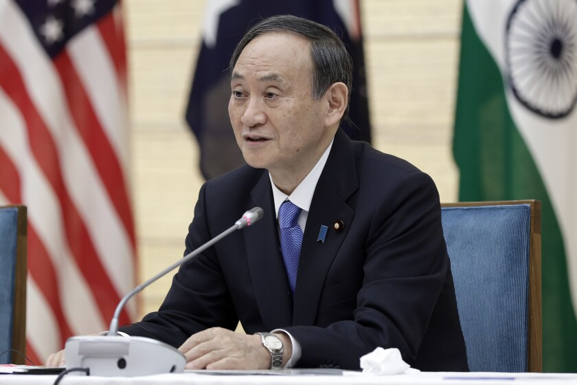 """Japan's Prime Minister Yoshihide Suga speaks during the virtual summit of the leaders of Australia, India, Japan and the U.S., a group known as """"the Quad"""", at his official residence in Tokyo, Japan, on Friday, March 12, 2021. (Kiyoshi Ota/Pool via AP)"""