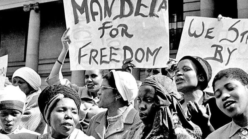 Protesters demonstrate on August 16, 1962, demanding Mandela's release after his second arrest. His wife Winnie, whom he had married in 1958, joined the protests. Mandela was sent to a penal colony off Cape Town, where he spent 13 years laboring in a quarry.