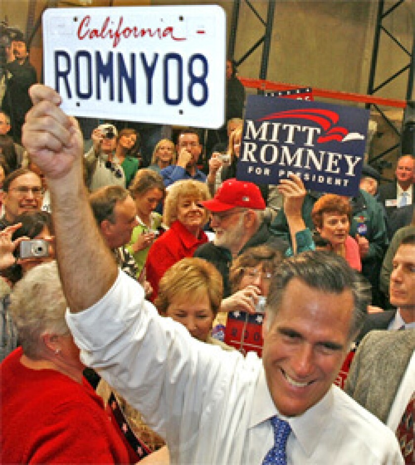 STAYING ALIVE: Mitt Romney, shown in Fountain Valley, is fundraising in California but also expected to dip further into his personal fortune as Super Tuesday nears.