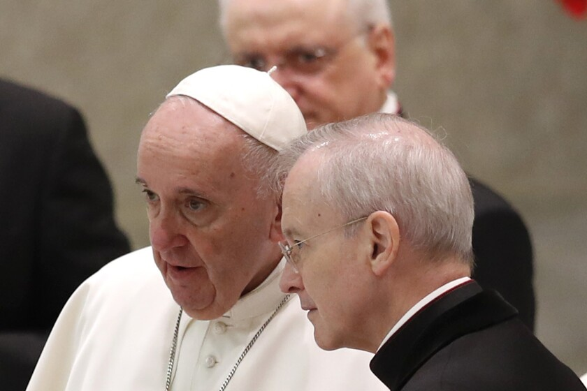 Pope Francis and Msgr. Luis Maria Rodrigo Ewart converse at the Vatican on Wednesday.