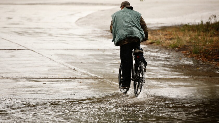 A cyclist finds wet riding conditions at the Hjelte Sports Center in Encino on May 16.