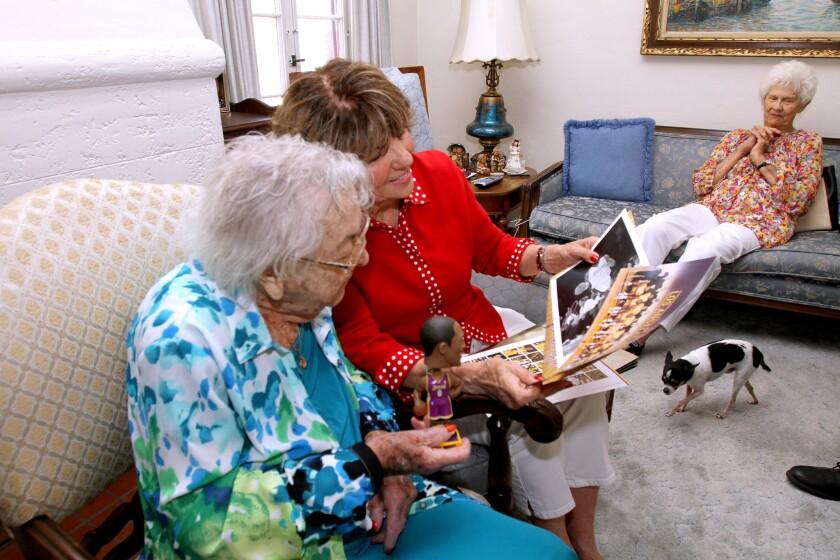 Gertrude Ness receives Lakers memorabilia