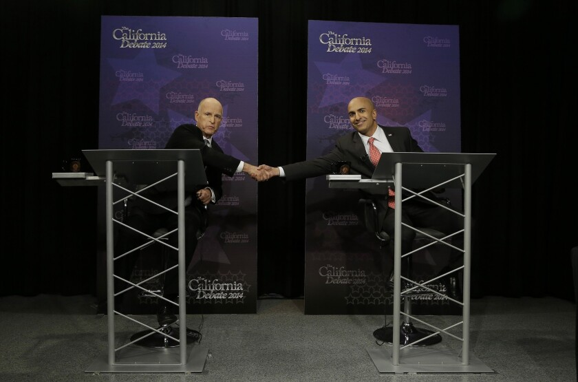 California Gov. Jerry Brown and challenger Neel Kashkari debate in Sacramento.