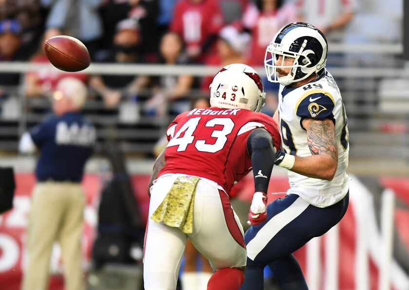 Rams tight end Tyler Higbee prepares to make one of his seven catches against the Arizona Cardinals.