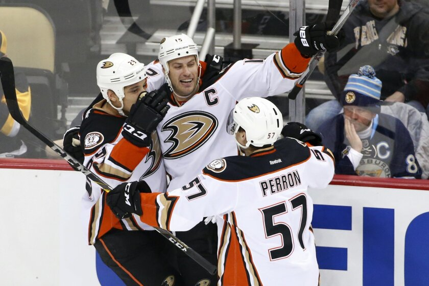 Anaheim Ducks' Ryan Getzlaf (15) celebrates his goal with teammates during the first period of an NHL hockey game against the Pittsburgh Penguins in Pittsburgh, Monday, Feb. 8, 2016. (AP Photo/Gene J. Puskar)