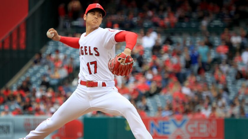 Angels starter Shohei Ohtani pitches in 2018.