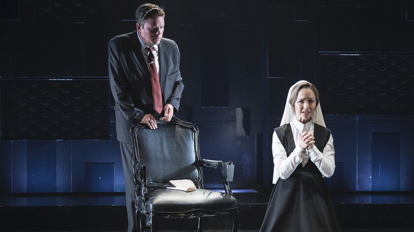 """An authoritarian despot (Richard Baird) uses sexual blackmail against the hapless heroine (Lily Gibson) in """"Measure for Measure"""" at the New Vic."""