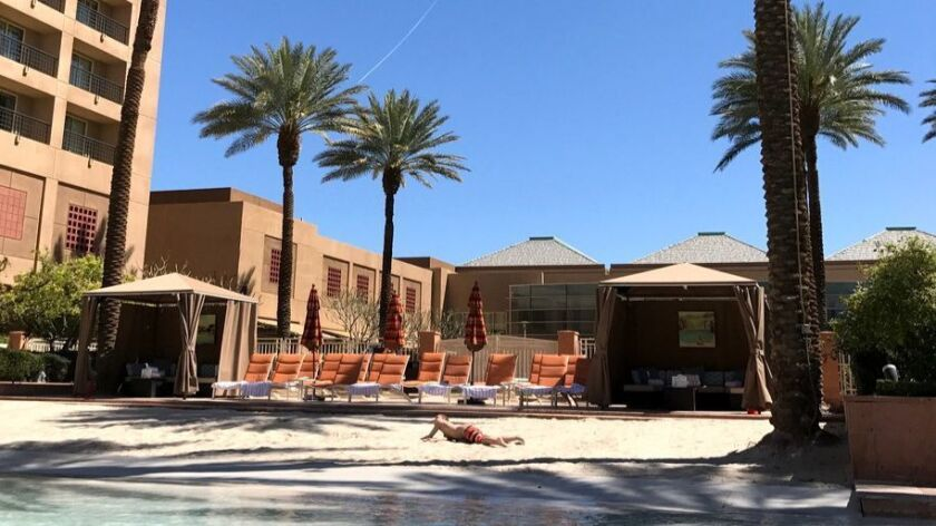 Sunbathing poolside at the Renaissance Indian Wells Resort & Spa before heading out for a long day a
