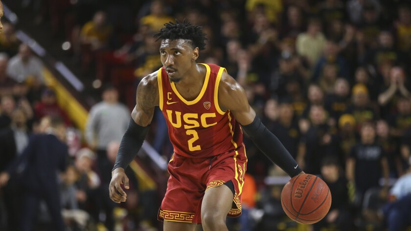 USC guard Jonah Mathews dribbles the ball against Arizona State during the first half of a game Feb. 8, in Tempe, Ariz. Arizona State defeated USC 66-64.