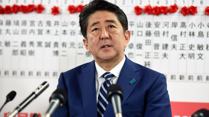 Japan's prime minister and ruling Liberal Democratic Party leader Shinzo Abe answers questions at the party headquarters in Tokyo on Oct. 22, 2017.