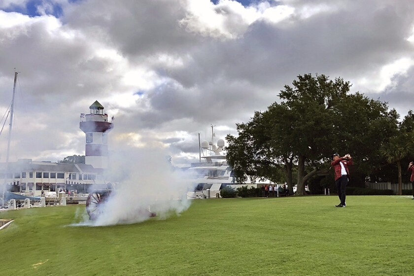 RBC Heritage defending champion C.T. Pan hits a ceremonial tee shot as a canon is fired Wednesday, June 17, 2020, at Hilton Head Island, S.C. The golf tournament begins Thursday. (Scott Schroeder/The Island Packet via AP)
