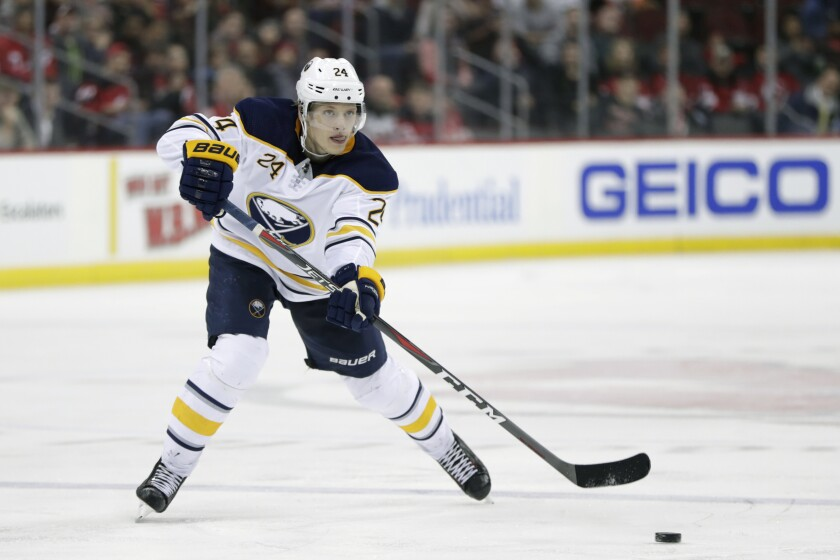 FILE - In this March 25, 2019, file photo, Buffalo Sabres defenseman Lawrence Pilut, of Sweden, plays against the New Jersey Devils during the third period of an NHL hockey game, in Newark, N.J. Pilut is leaving the team after signing a two-year contract with Traktor Chelyabinsk, of the Kontinental Hockey League. (AP Photo/Julio Cortez, File)