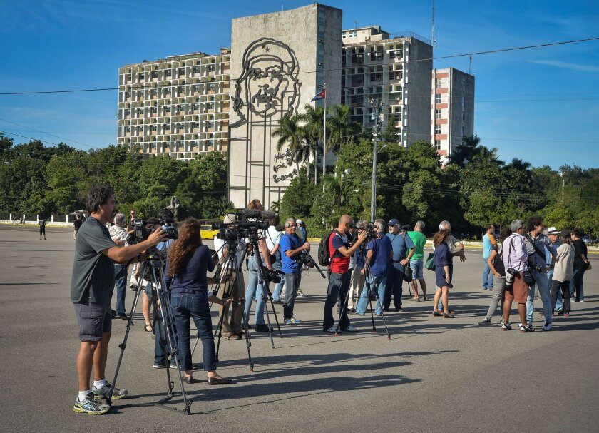 Journalists wait for Cuban performance artist Tania Bruguera at Revolution Square in Havana on Tuesday. Bruguera had announced that she would set up an open mic for ordinary citizens to express their views. According to her family, the artist was detained before the activity could be held.