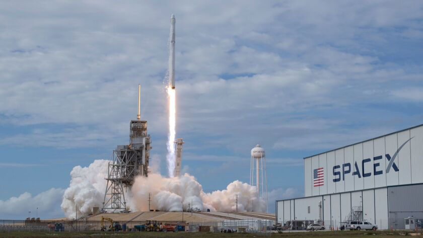 In this photo provided by NASA, the SpaceX Falcon 9 rocket, with the Dragon spacecraft onboard, laun