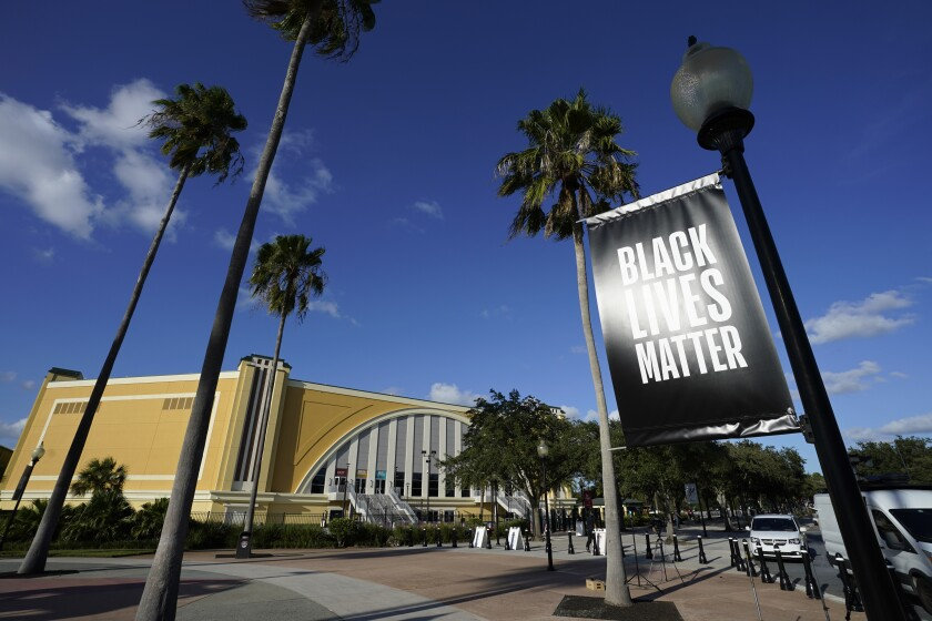 A Black Lives Matter banner hangs outside the arena in Florida where the Milwaukee Bucks refused to take the court Wednesday.