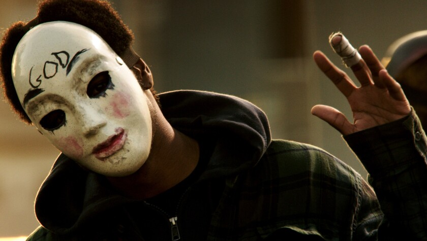 """""""The Purge: Anarchy"""" performed well but couldn't unseat """"Dawn of the Planet of the Apes"""" as box office king."""