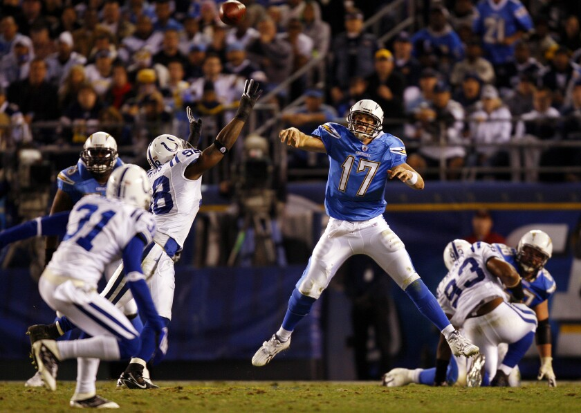 Chargers' Philip Rivers throws a pass against the Colts in a playoff game on Jan. 3, 2009. If the two teams face each other in the 2020 playoffs, Rivers will be playing for Indianapolis.