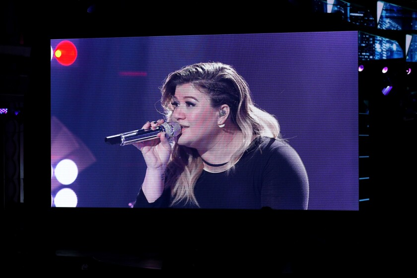 """Kelly Clarkson appears during the April """"American Idol"""" series finale in a mini-concert taped in February."""