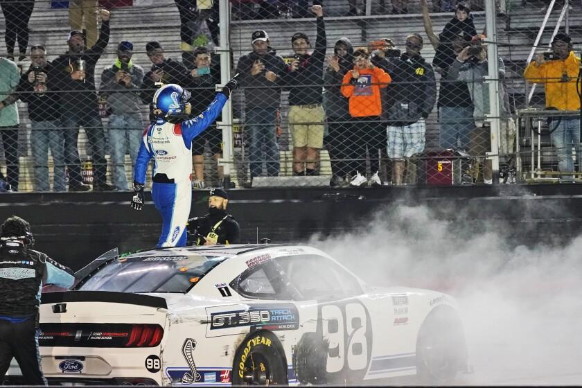 Chase Briscoe celebrates winning the NASCAR Xfinity Series auto race Friday, Sept. 18, 2020, in Bristol, Tenn. (AP Photo/Steve Helber)