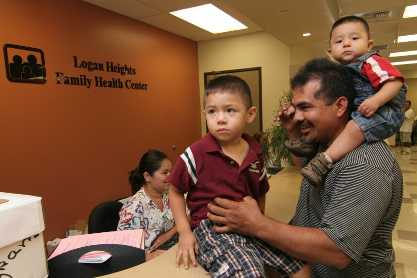Benito Jimenez, whose family doesn't have insurance, took his sons to the Logan Heights Family Health Center. The clinic was founded in the early 1970s. (Marcos Gonzalez)