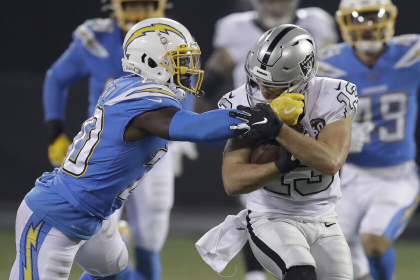 Oakland Raiders wide receiver Hunter Renfrow, right, runs against Los Angeles Chargers defensive back Desmond King II (20) during the second half of an NFL football game in Oakland, Calif., Thursday, Nov. 7, 2019. (AP Photo/Ben Margot)