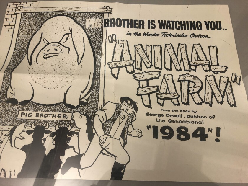 "In this Oct. 21, 2019, photo, a poster promoting a cartoon version George Orwell's novel ""Animal Farm"" is shown at an exhibit in Albuquerque, N.M. celebrating the author's legacy. The exhibit at the University of New Mexico is tackling the themes of the novelist's work from ""1984"" to ""Animal Farm."" ""George Orwell: His Enduring Legacy,"" which runs to April 2020, features posters and material related to work challenging totalitarianism. (AP Photo/ Russell Contreras)"