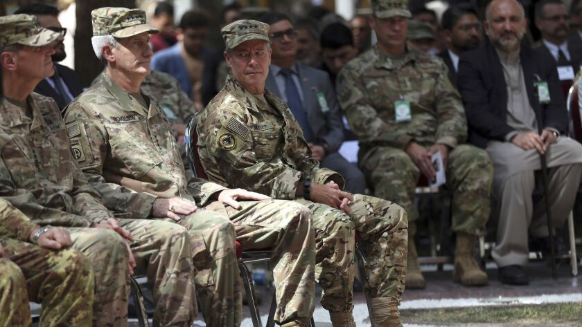 As he takes over as leader of the Resolute Support mission in Afghanistan, Gen. Austin S. Miller, third from left, looks at retiring Gen. John Nicholson, second from left, during the change of command ceremony at Resolute Support headquarters in Kabul on Sept. 2.