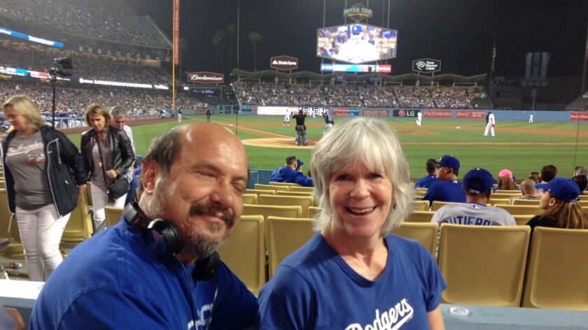 """Phil and Jessie Wojdak attend Dodgers games regularly: """"Sometimes I know it's going to be a home run by the sound of the bat,"""" he says."""