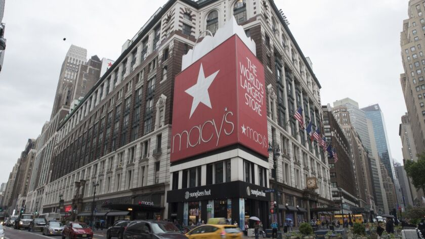 FILE- In this May 16, 2018, file photo, traffic makes it's way past the Macy's flagship store in New