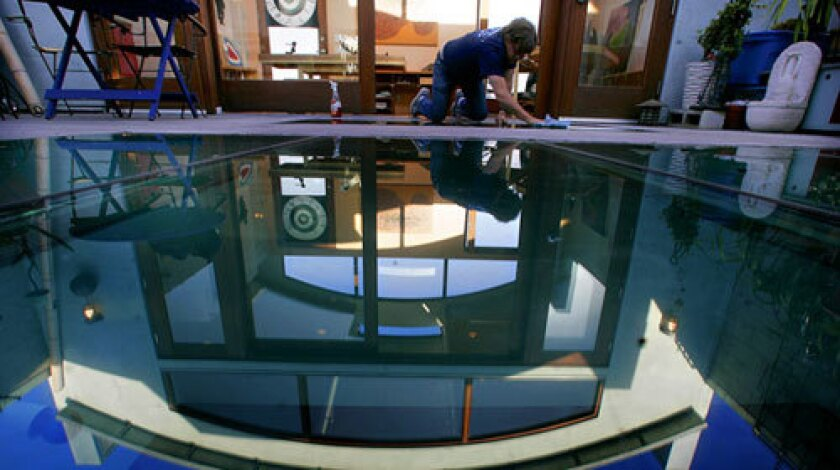 A pool? Nope, just the glass floor at the Venice home of artist Nancy Evans and woodworker Tucker Strasser.