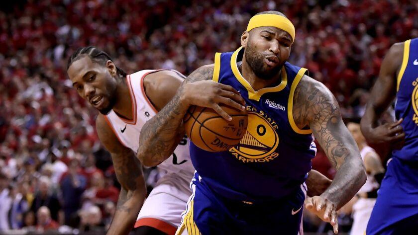 Toronto Raptors forward Kawhi Leonard (2) looks on as Golden State Warriors centre DeMarcus Cousins
