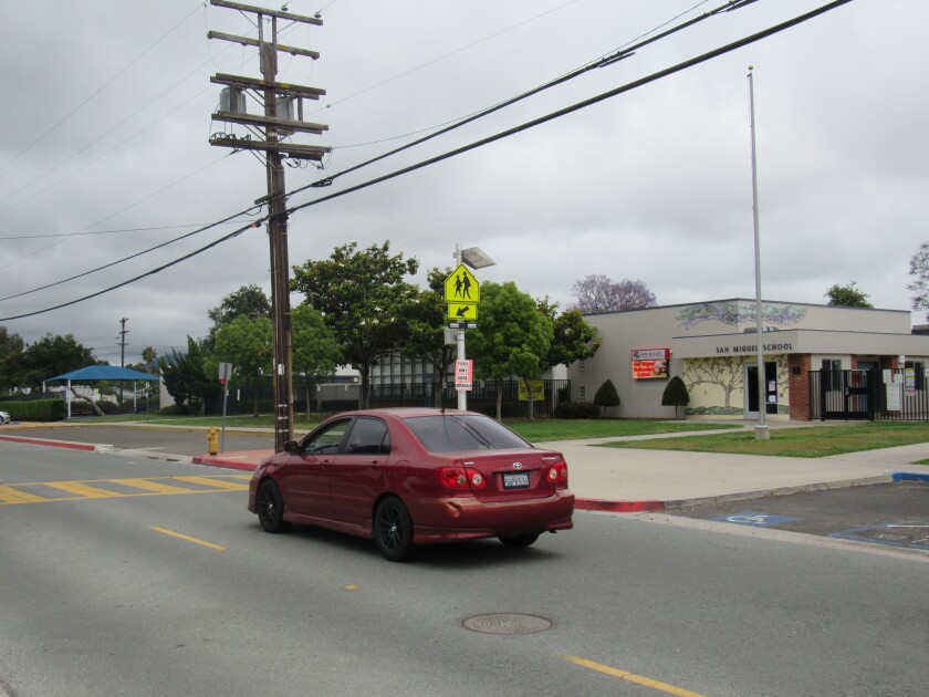 A car heads down San Miguel Avenue toward Massachusetts Avenue in Lemon Grove. The City Council discussed safety measures along the street in front of San Miguel Elementary School after a 13-year-old boy was killed in front of the school in May.