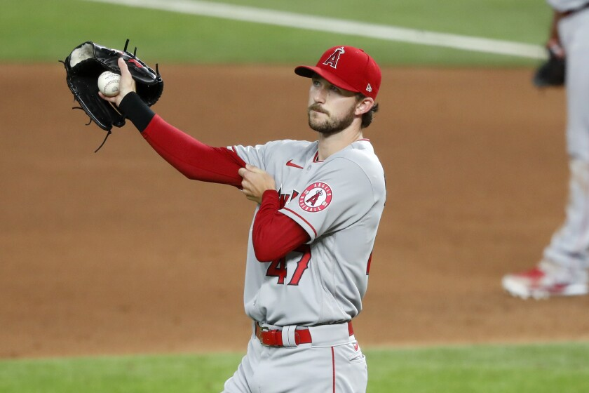 Angels starting pitcher Griffin Canning walks behind the mound after giving up a single.