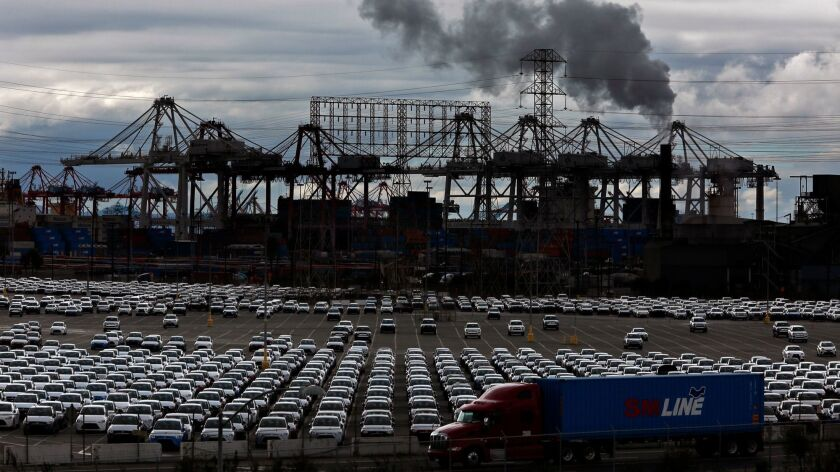 LONG BEACH, CA -- NOVEMBER 1, 2017 -- A truck drives by a fleet of parked cars at the Port of Long