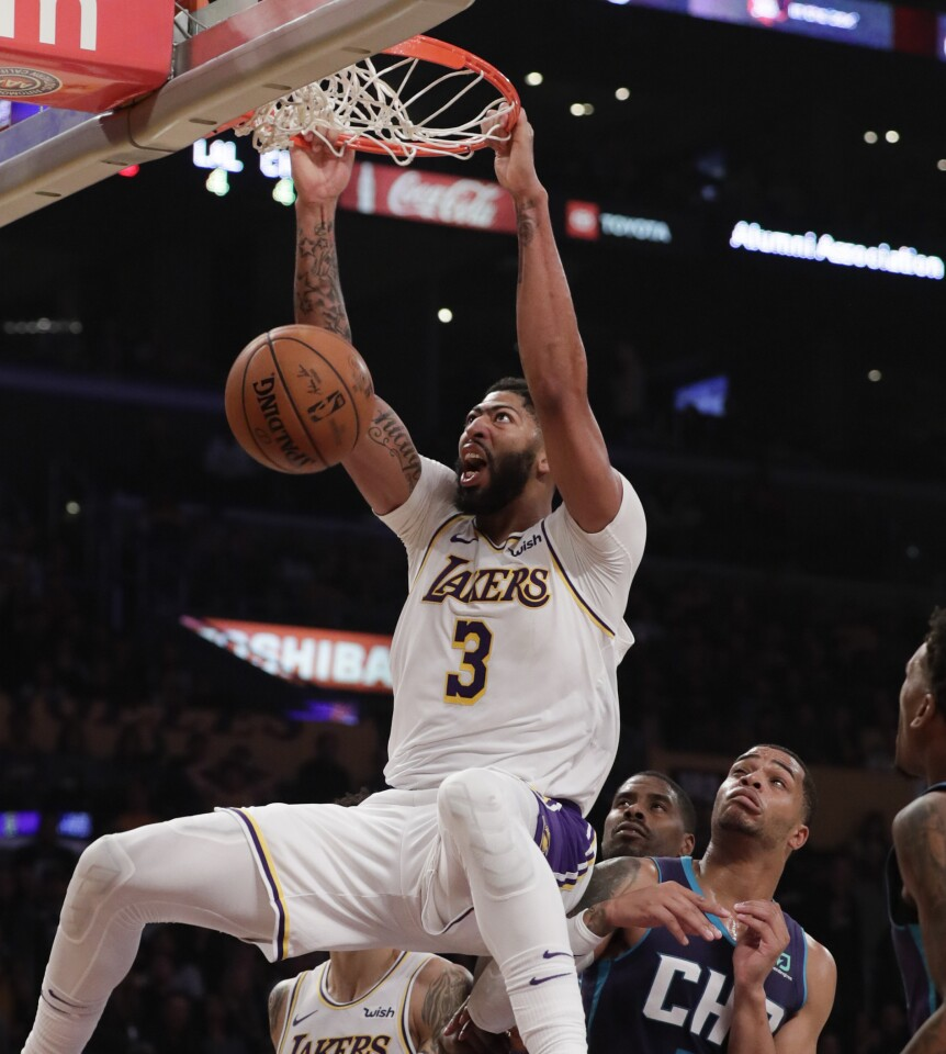 LOS ANGELES, CA, SUNDAY, OCTOBER 27, 2019 - Los Angeles Lakers forward Anthony Davis (3) slams the ball home over Charlotte Hornets forward Miles Bridges (0) during second quarter action at Staples Center.(Robert Gauthier/Los Angeles Times)
