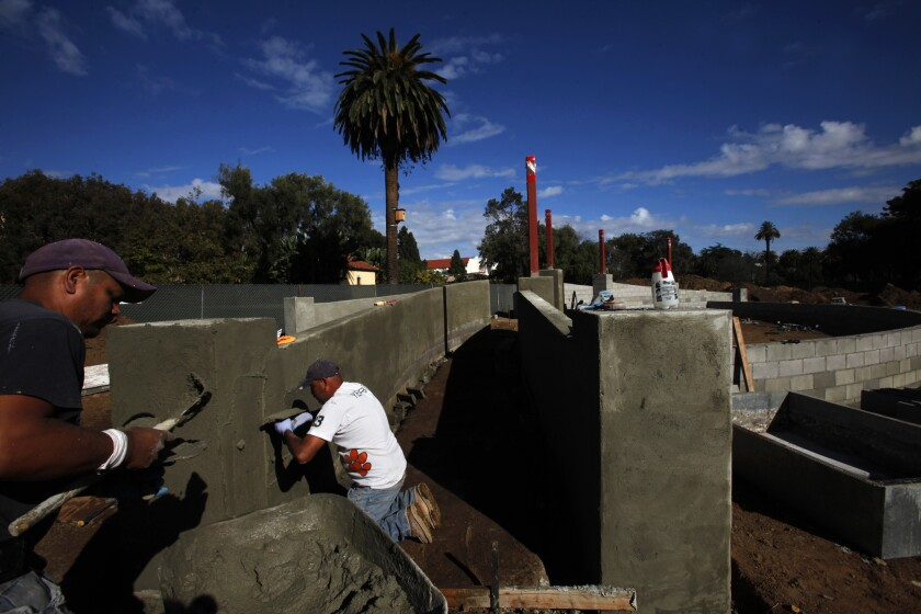 Construction workers build the Hollywood Canteen Amphitheater at the West Los Angeles campus of the U.S. Department of Veterans Affairs on Nov. 19.