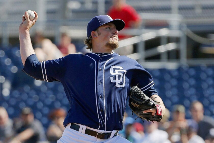 San Diego Padres' Brandon Maurer throws a pitch against the Arizona Diamondbacks during the first inning of a spring training baseball game Tuesday, March 8, 2016, in Peoria, Ariz. (AP Photo/Ross D. Franklin)