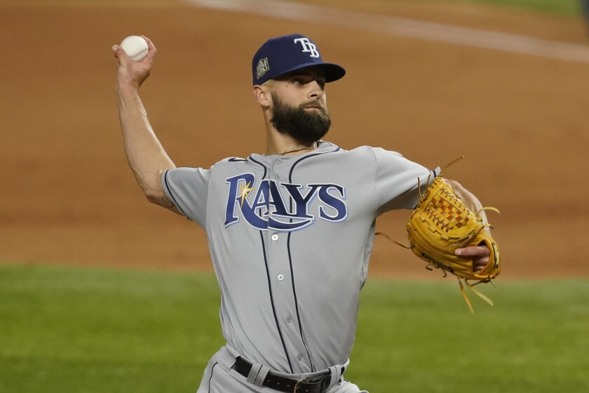 Tampa Bay Rays relief pitcher Nick Anderson throws against the Dodgers.