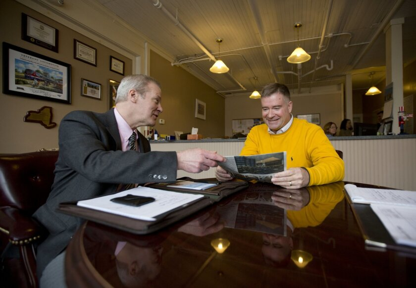 In this Friday, Jan. 29, 2016 photo, Rep. Chris Gibson, R-N.Y., right, meets with Stephen Manny of the Community Hospice Foundation, in his district office in Kinderhook, N.Y. The 51-year-old Gibson is edging closer to a 2018 run for governor, an office Democrats have held since 2006. (AP Photo/Mik