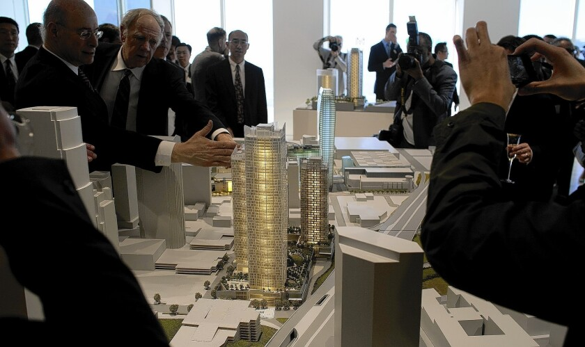 A model of the Metropolis, a 350-room hotel and residential tower proposed for downtown Los Angeles, is shown. The developer, Greenland US Holding Inc., says it needs as much as $92 million in financial help to fill a budget gap in the project, according to a report prepared for the City Council.