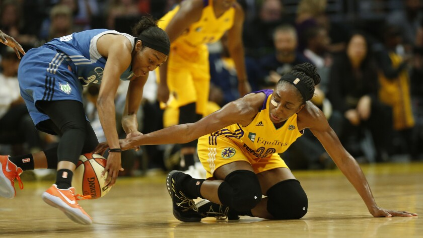 Sparks forward Nneka Ogwumike goes for the steal as Lynx guard Renee Montgomery loses control of the ball in the first half.