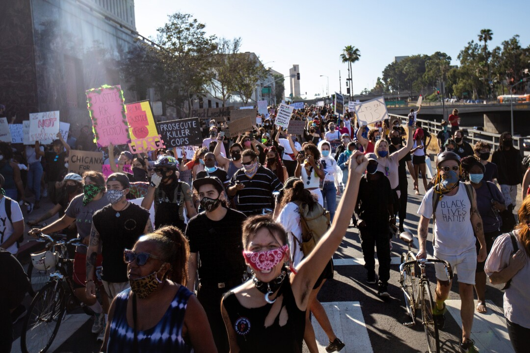 Protesters organized by Black Lives Matter-LA march down Aliso Street in downtown Los Angeles.