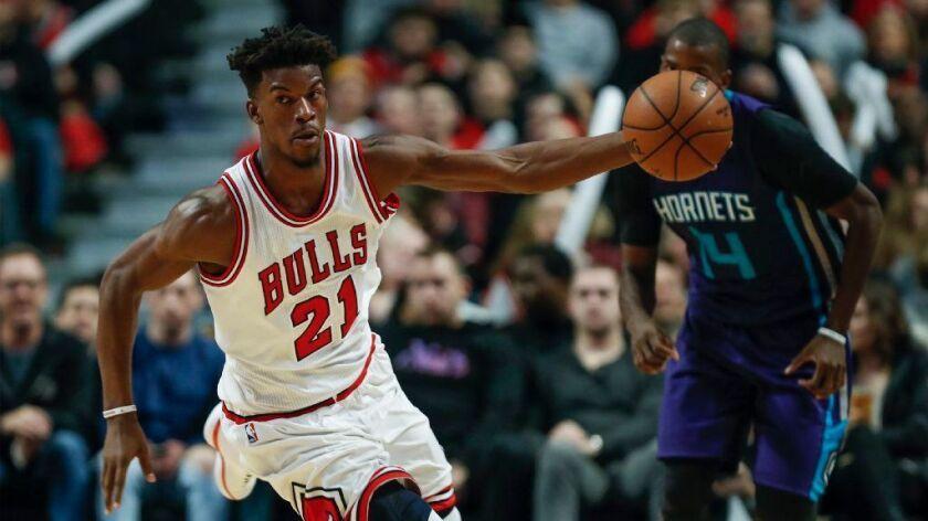 NBA: Jimmy Butler scores 42 as Bulls rally past Raptors, 123-118, in overtime