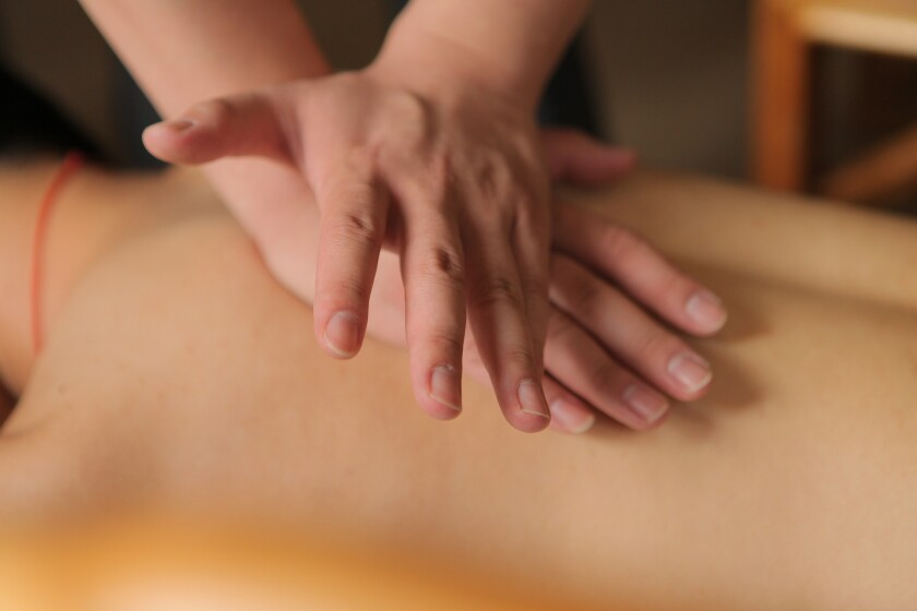 massage pic1 hands on back.jpg