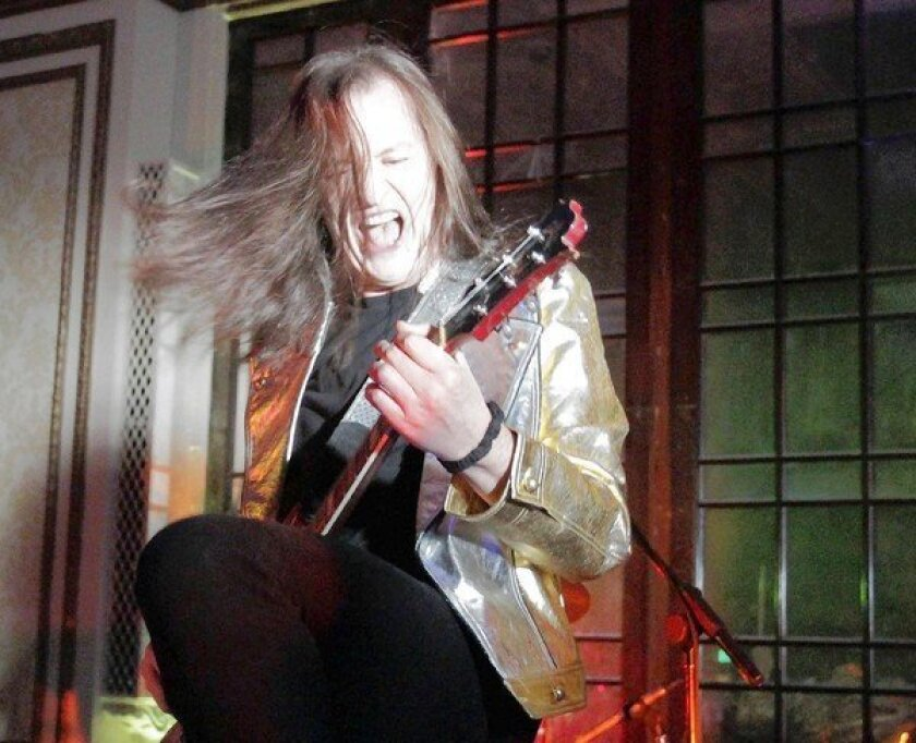 Redd Kross' Jeff McDonald lets loose during a New Year's Eve show at the Alexandria in downtown L.A. Also on the bill: fellow punk band the Melvins.